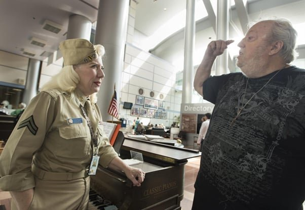 (Above image: Judy Gascon talks with one of her regulars, Wendell T. Halseth, who served with the Navy in Vietnam)